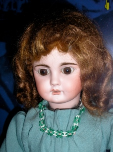 Close up of the doll at the National Park. There's a little glare on the image from the case. Photo by me.